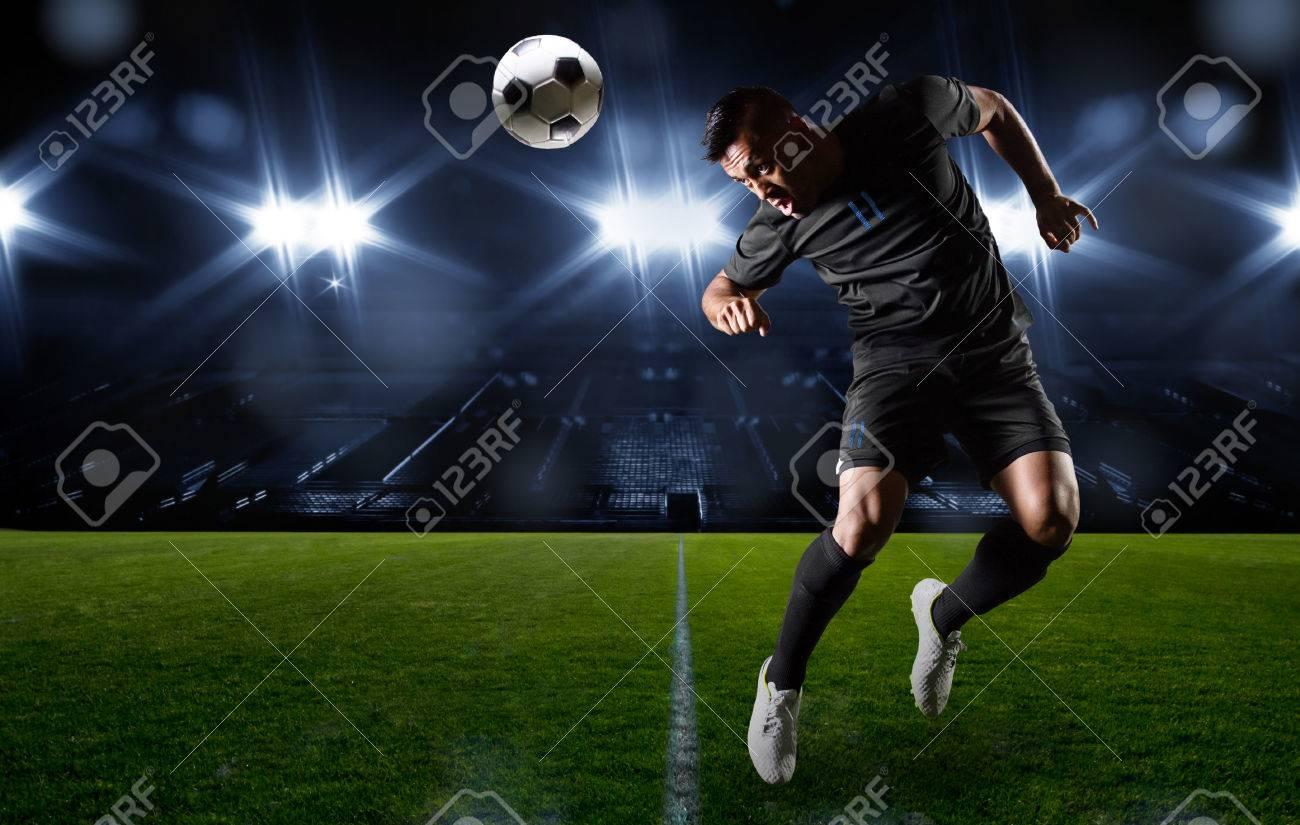 Hispanic Soccer Player heading the ball - 29584123