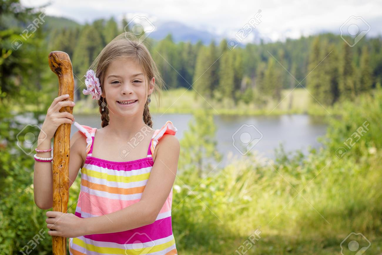 Little Girl Hiking In The Mountains On A Family Vacation Stock Photo
