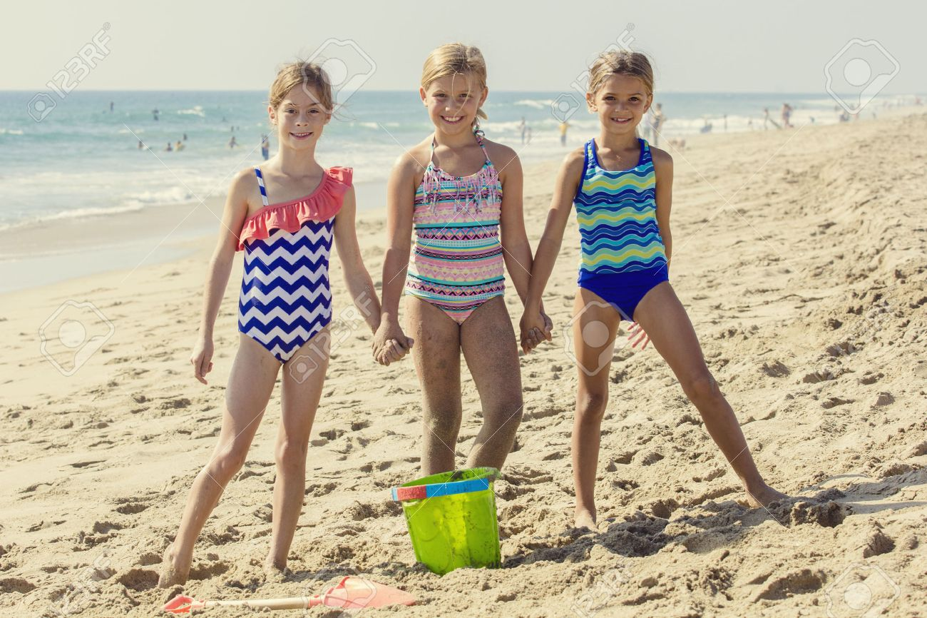 Cute Portrait Of Three Best Friends Playing Together At The Beach