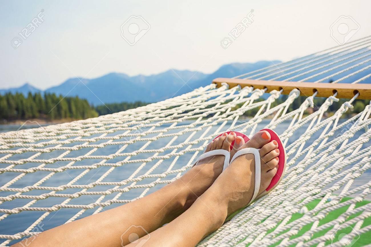 Woman relaxing in a hammock on a beautiful Mountain Lake - 54565624