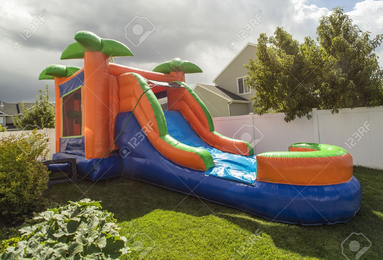 Inflatable Bounce House Water Slide In The Backyard Stock Photo   54561871