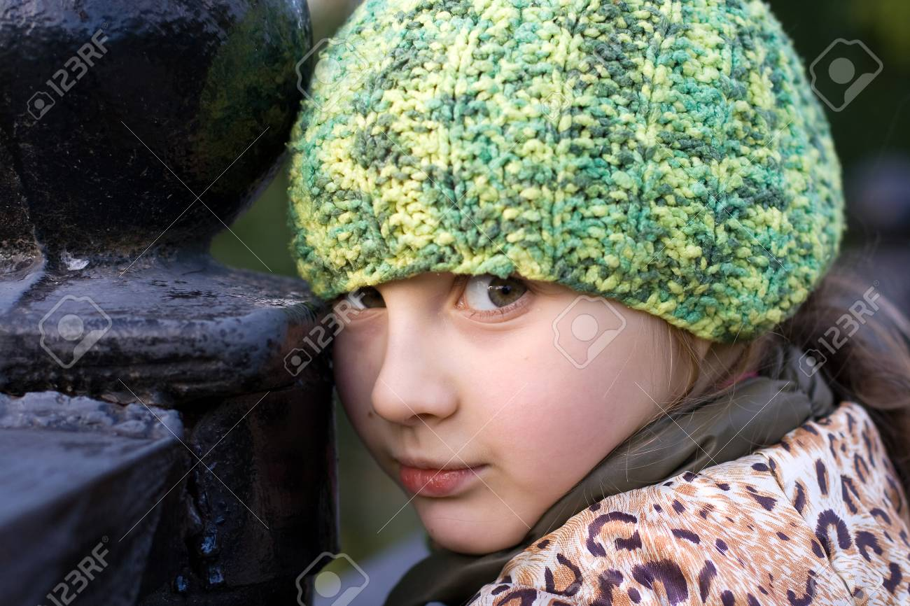 3a619e78719 Portrait of cute little girl in knitted hat Stock Photo - 44945911