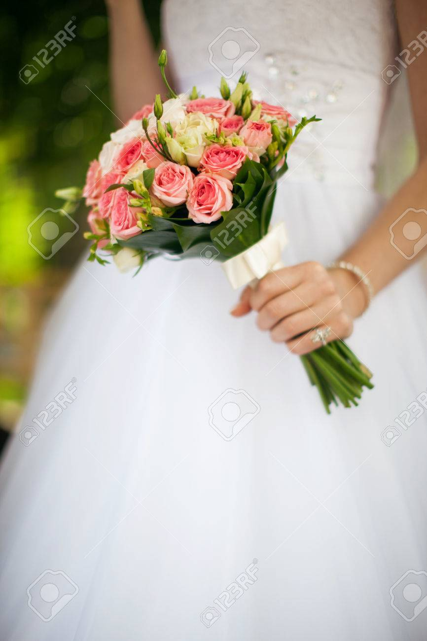 Bride In White Wedding Dress Holding A Bouquet Of White And Pink ...