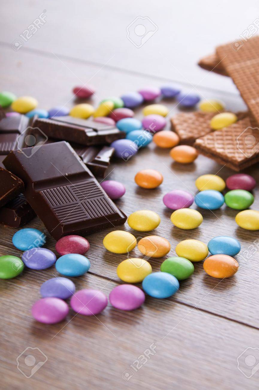 Vertical Photo With Many Colorful Chocolate Coated Sweets Among