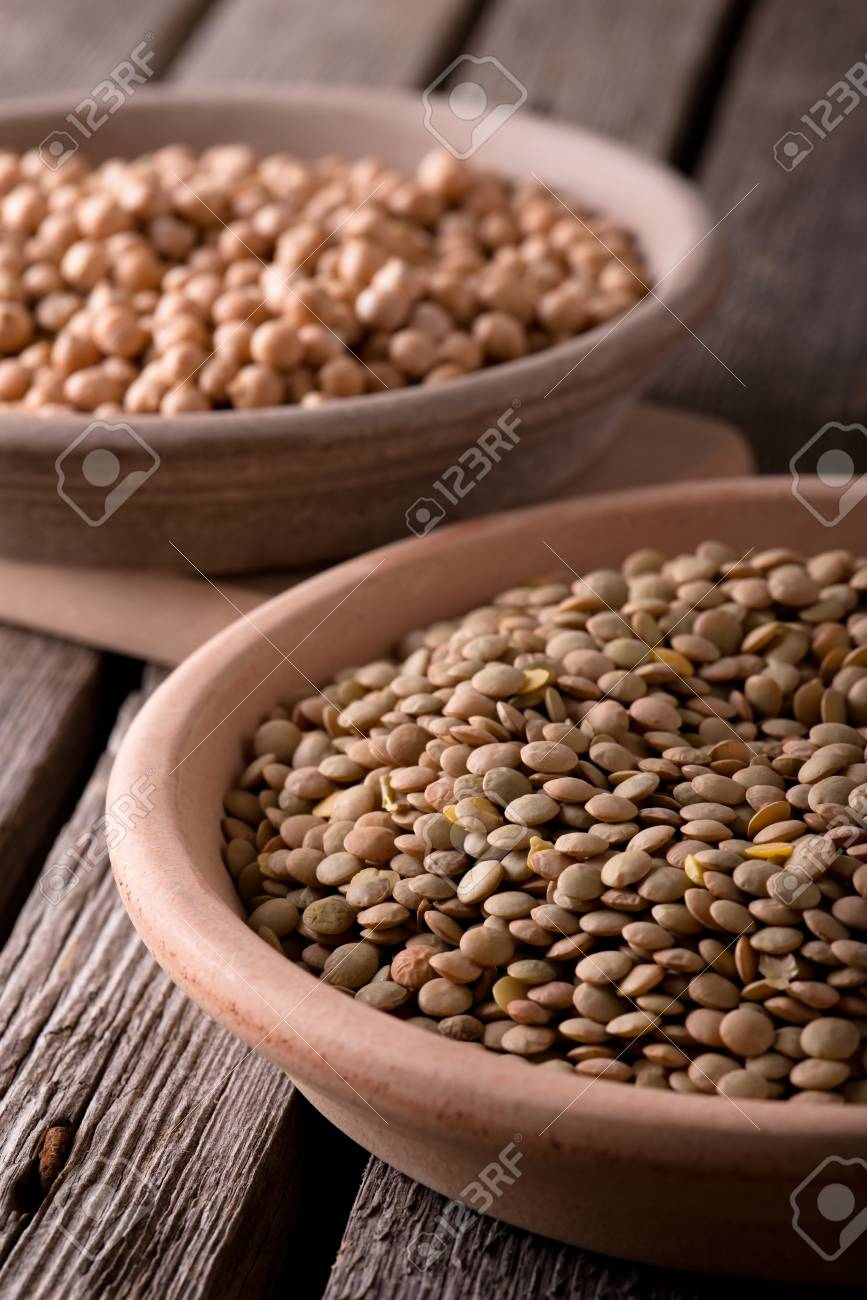 Vertical Photo Two Clay Plates Two Earthen Bowls With Legumes Stock Photo Picture And Royalty Free Image Image 56494485