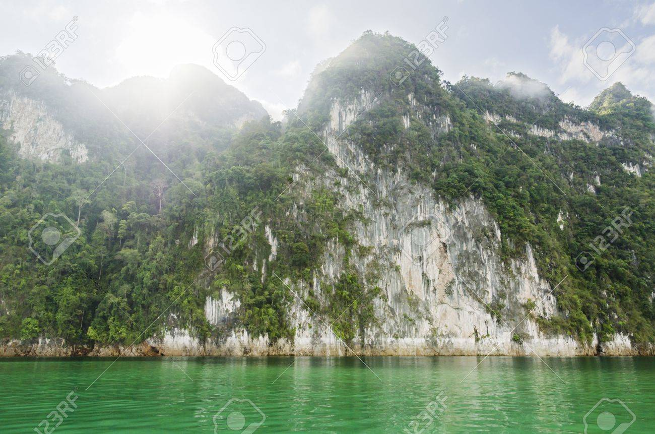 Beautiful high mountains and river in the morning at Ratchaprapha Dam, Khao Sok National Park, Surat Thani Province, Thailand Stock Photo - 21571813