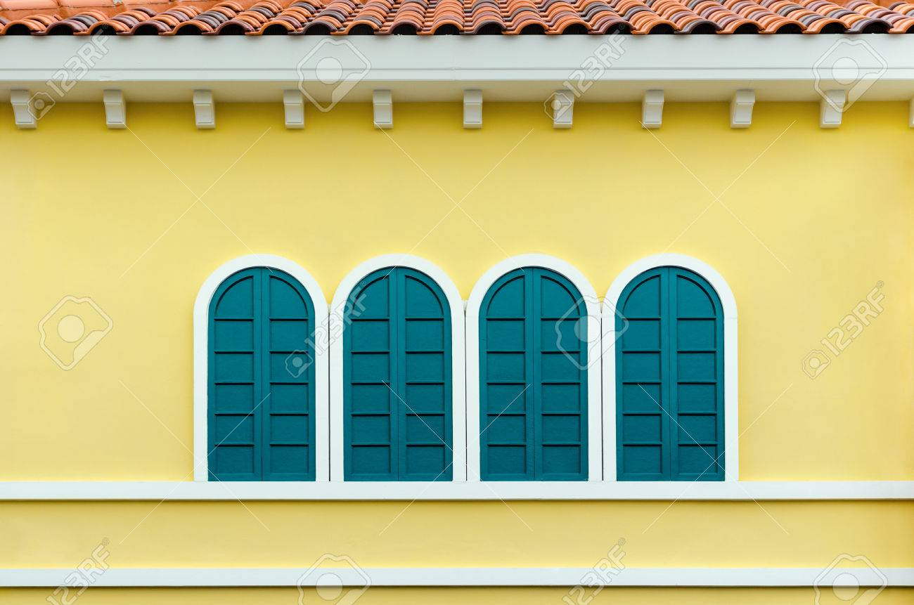 Four Green Arched Windows On Yellow Wall Of The House In Italy ...