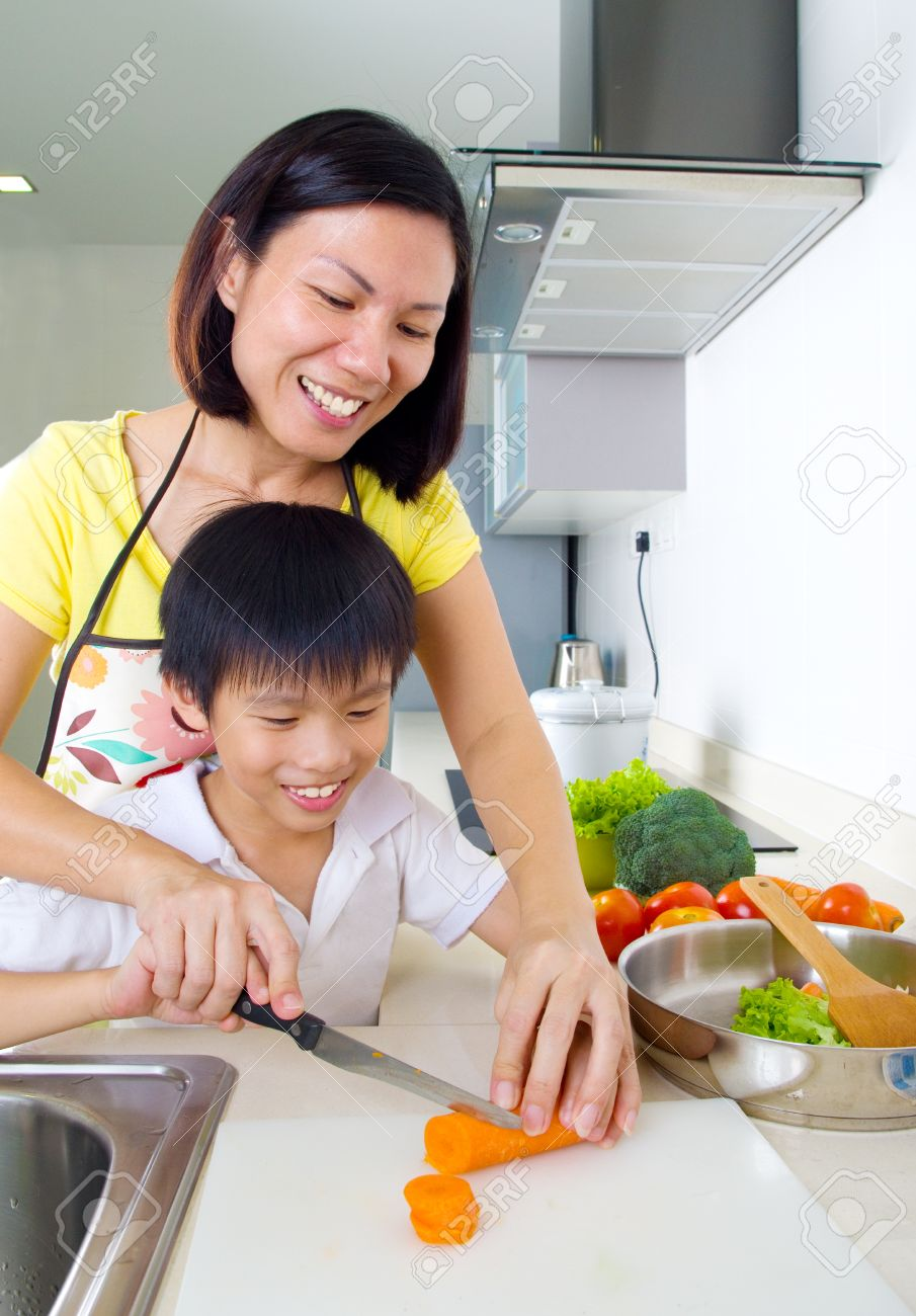 Asian mother and son cooking in the kitchen Stock Photo - 43126045