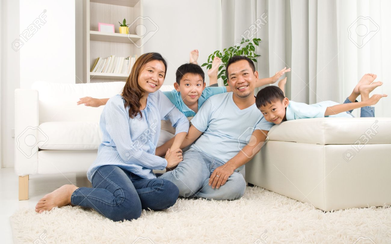 Asian Family Having Fun At Home Stock Photo Picture And Royalty
