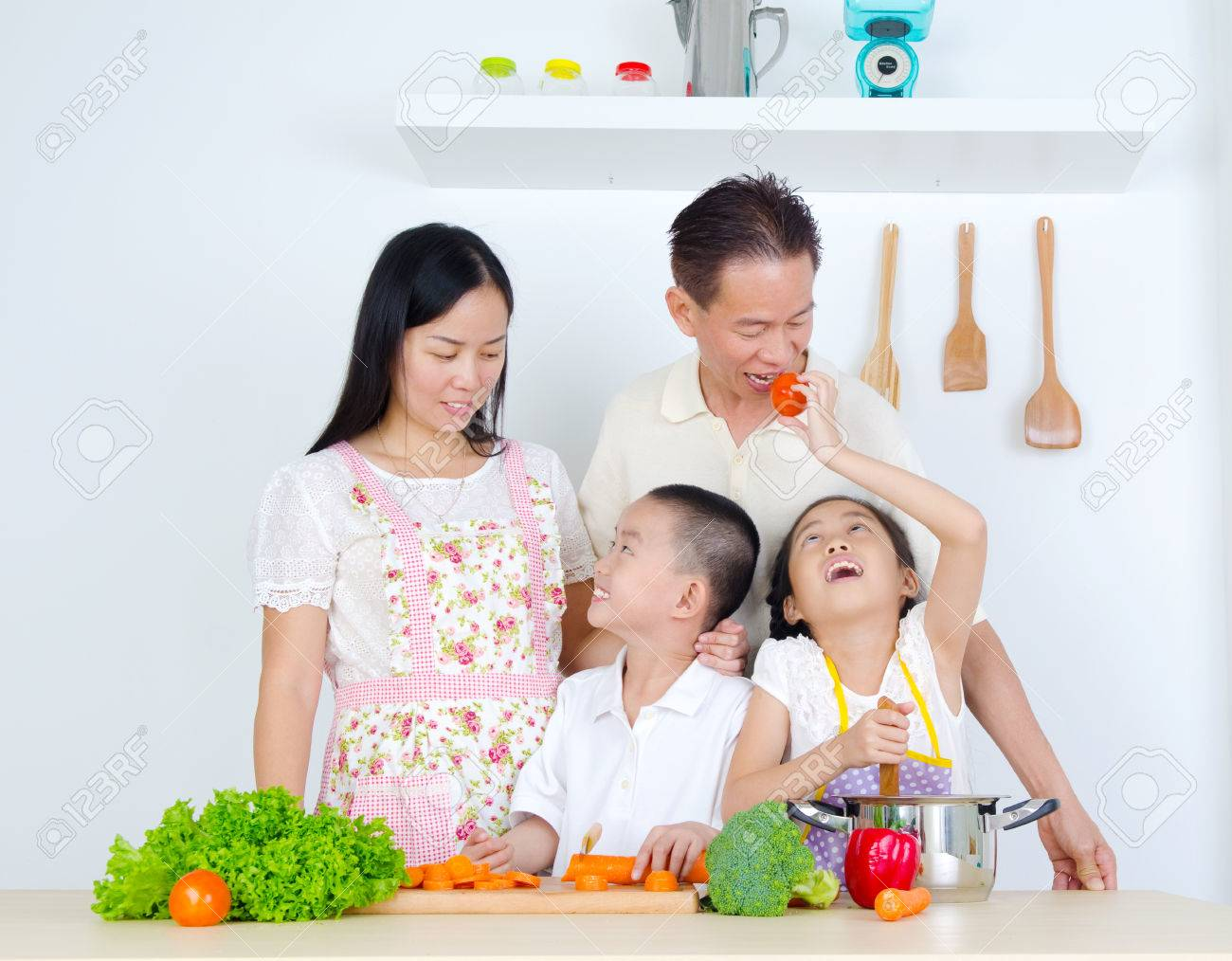 Family cooking kitchen - Asian Family Cooking In The Kitchen Stock Photo 45043114