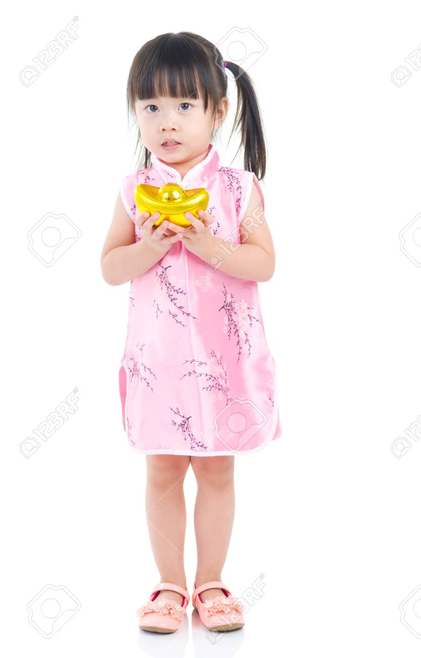 927756efa7941 Full length China girl in traditional Chinese dress greeting, holding a  gold ingot standing isolated