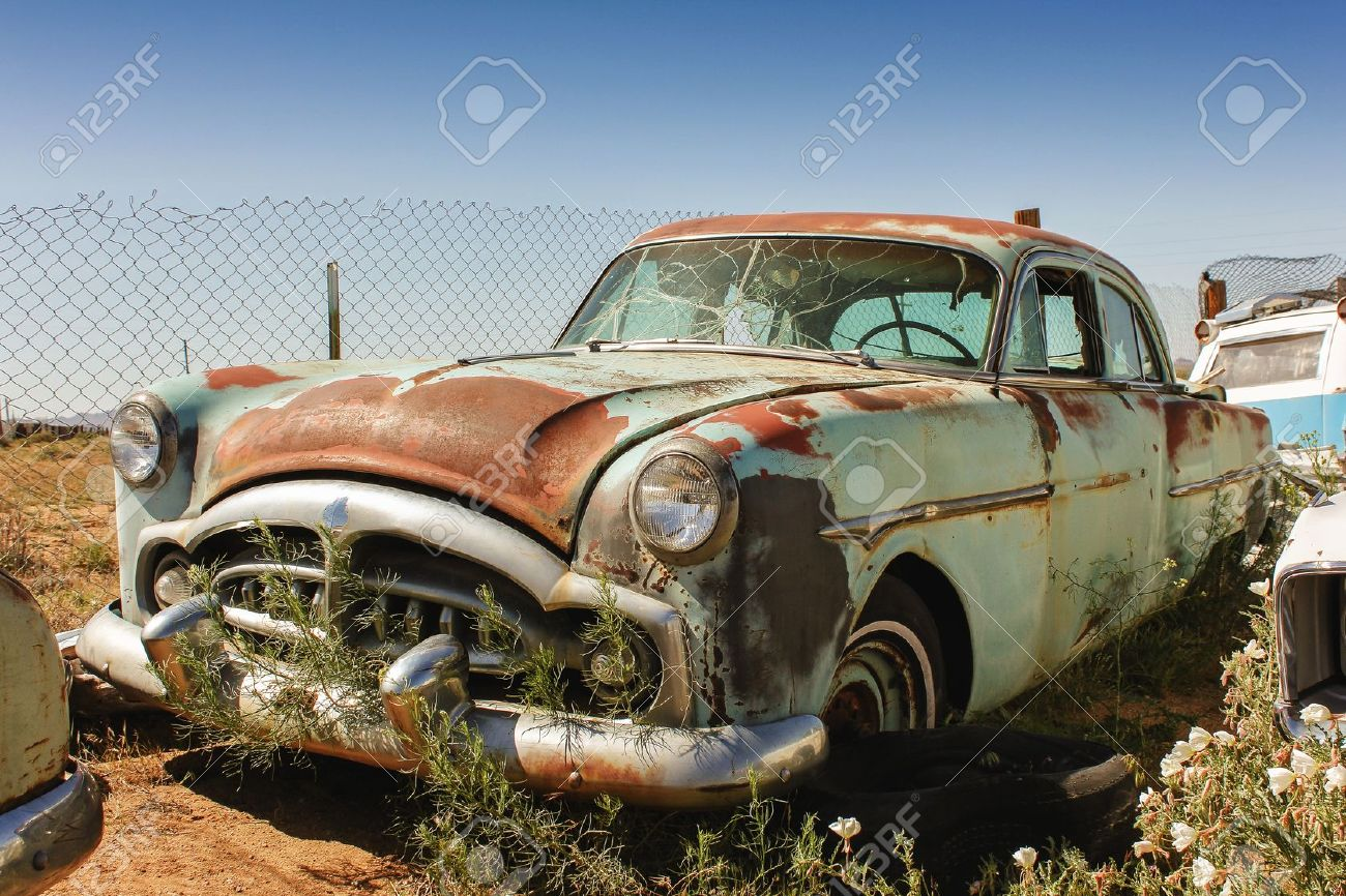 Old Rusted Car On An American Junkyard Stock Photo, Picture And ...