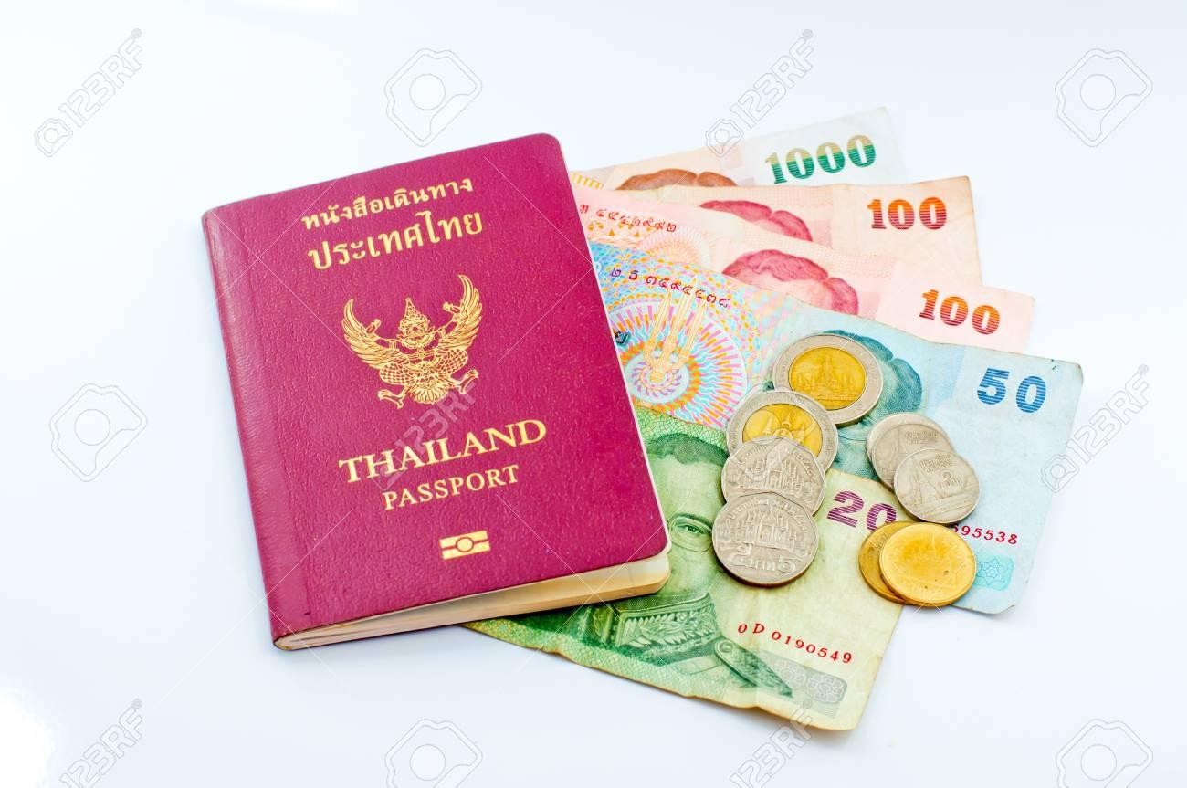 Thailand passport and Thai money Stock Photo - 12543233