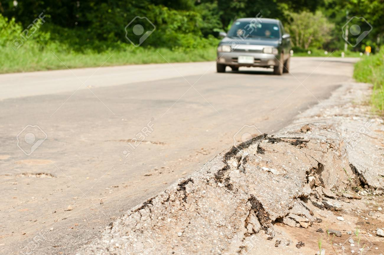 cracked road and  car Stock Photo - 14269995