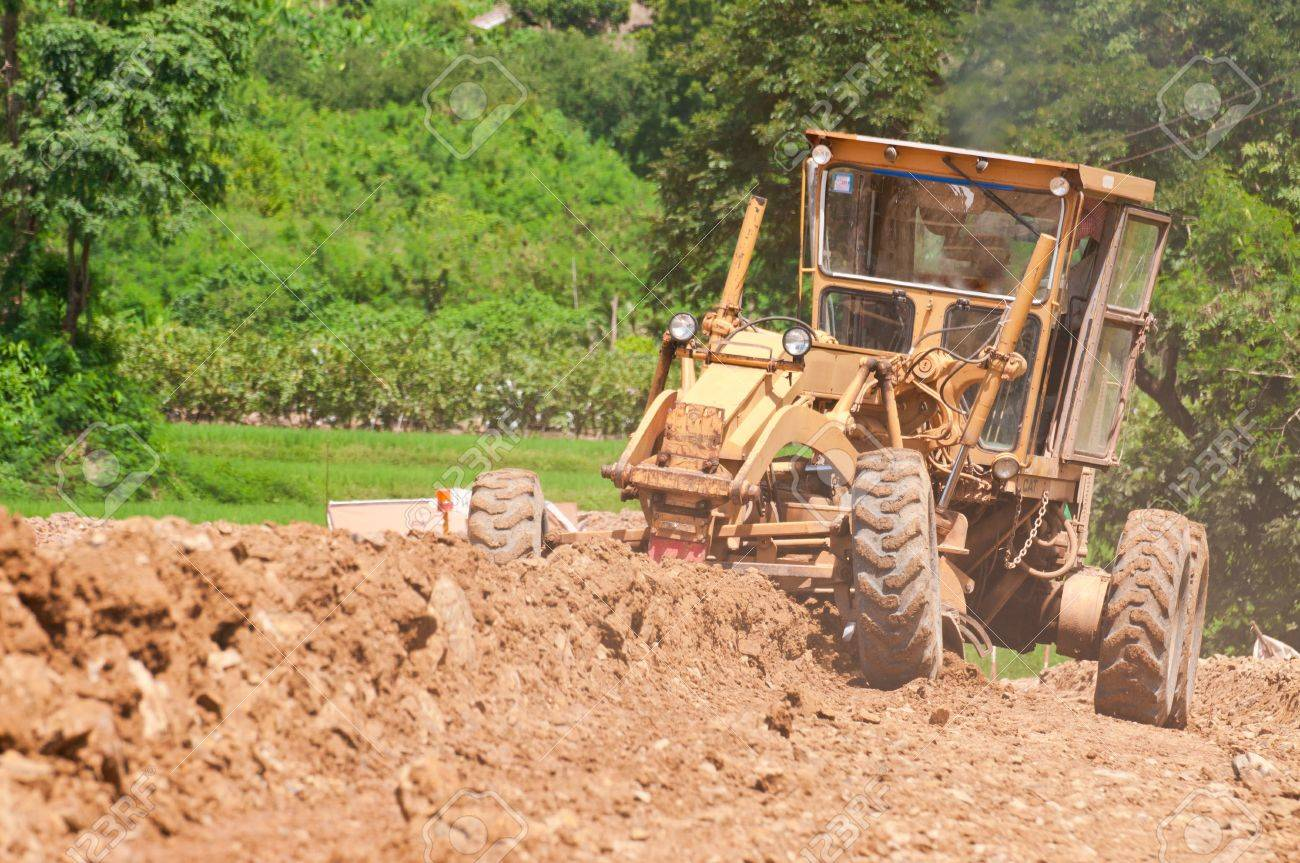 grader leveling the under construction road Stock Photo - 15234592