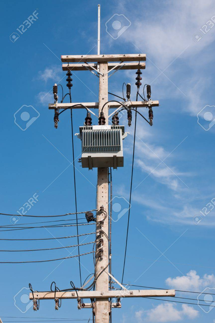 energy and technology electrical post by the road with power stock