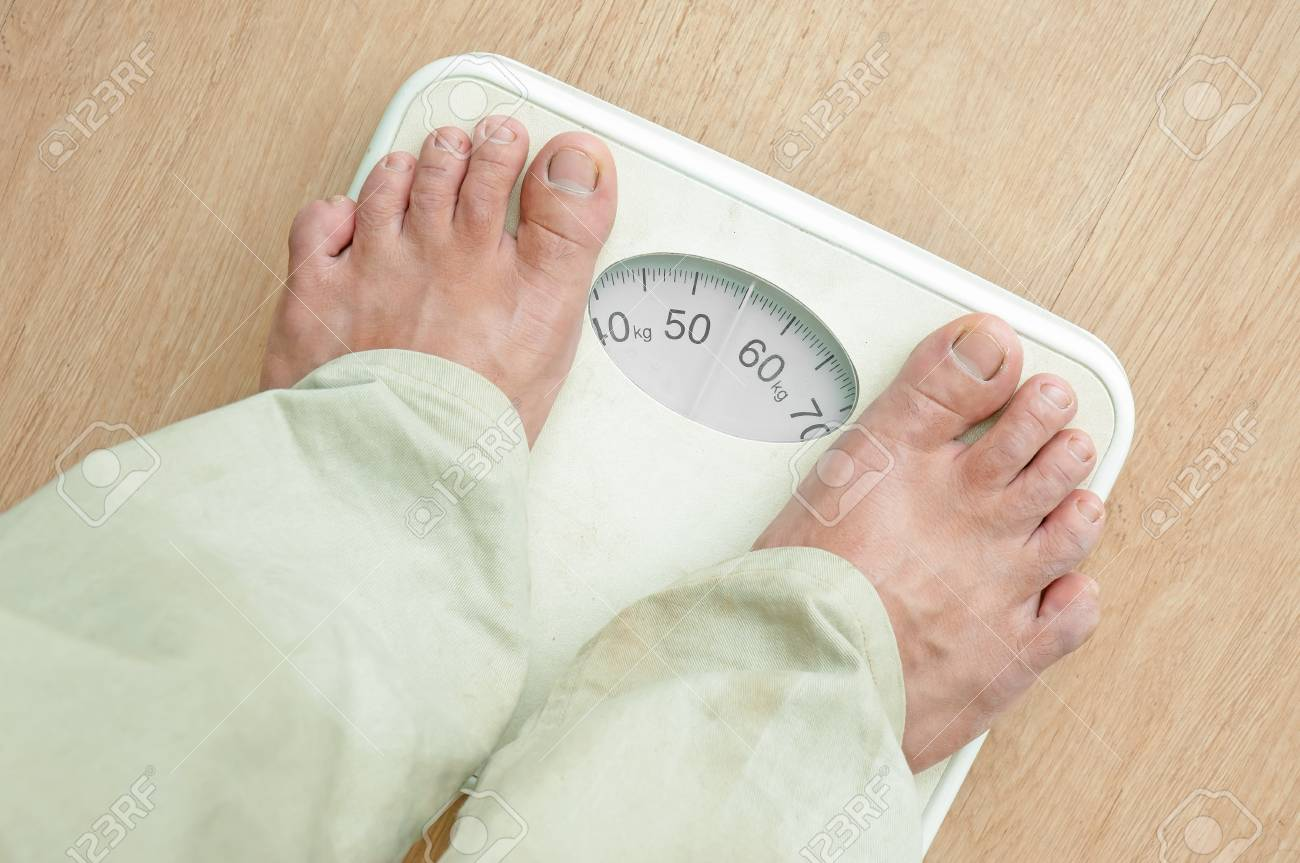 Man Standing On Weight Scales With Bare Foot Stock P O 21303738
