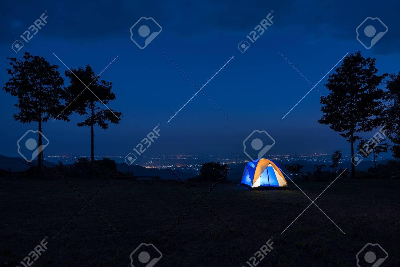 Illuminated Blue Camping tent at Night - 51005424
