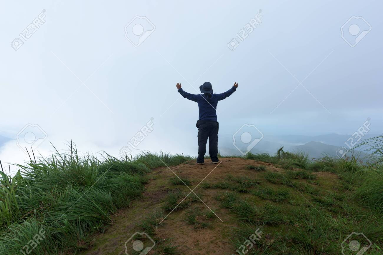 Man traveler on cliff with beautiful foggy in national park. - 143720192