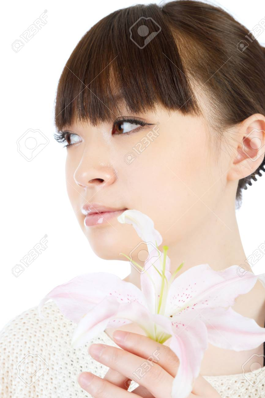 Beautiful young woman and flower Stock Photo - 12330542
