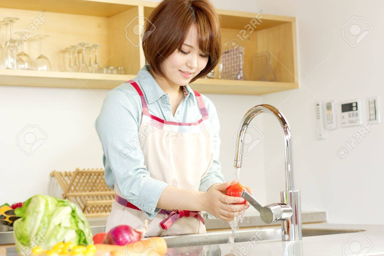 Beautiful woman standing in kitchen Stock Photo - 13163532
