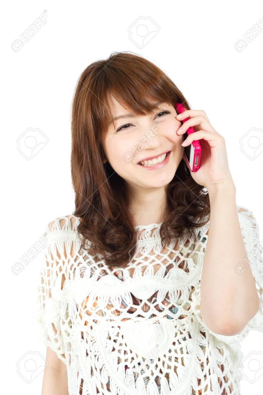 Beautiful young woman using smart phone Stock Photo - 13306104