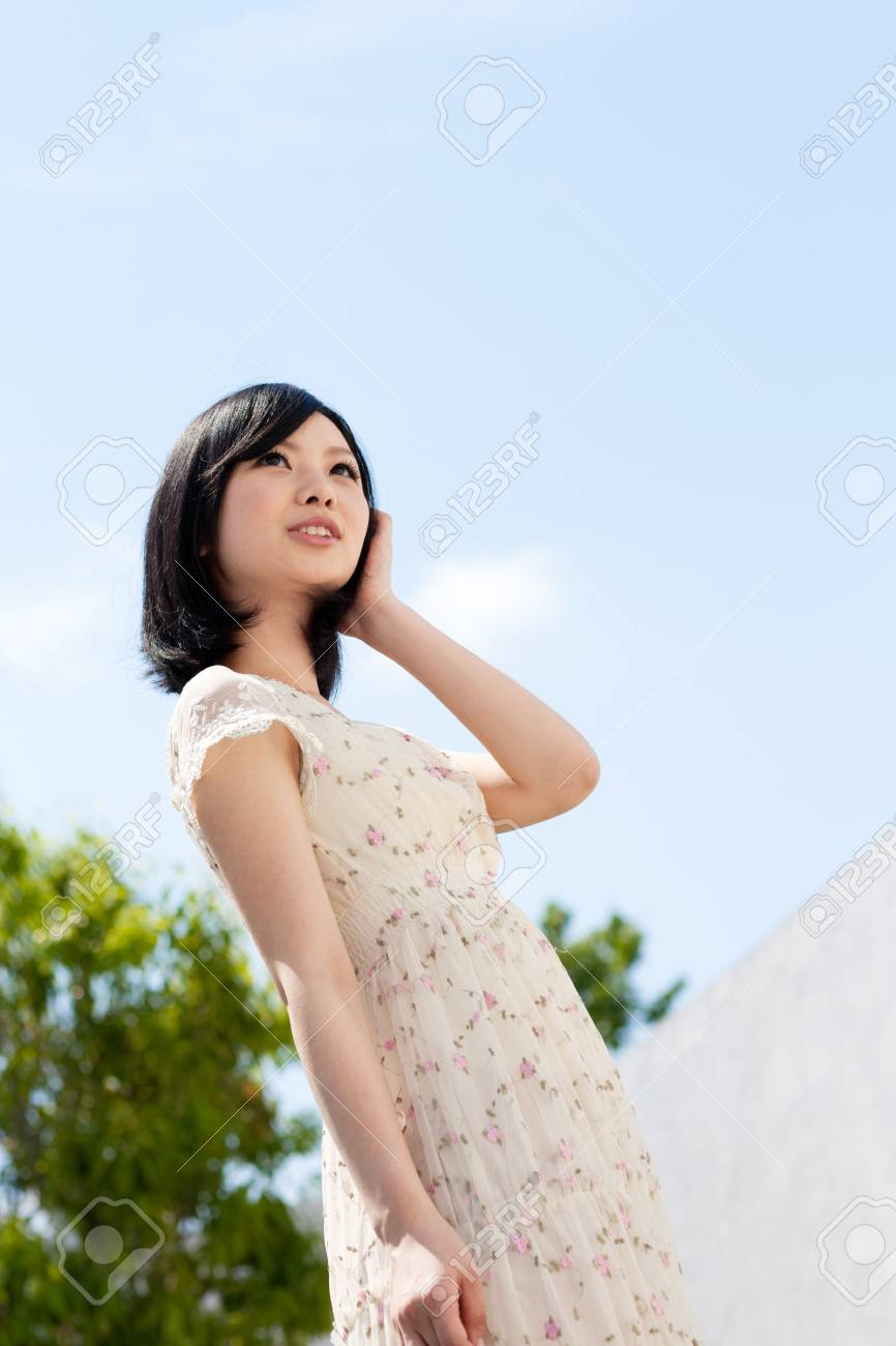 Beautiful young woman outdoors over blue sky Stock Photo - 13736266