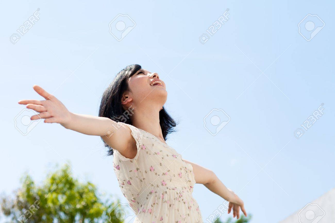 Beautiful young woman outdoors over blue sky Stock Photo - 13736265