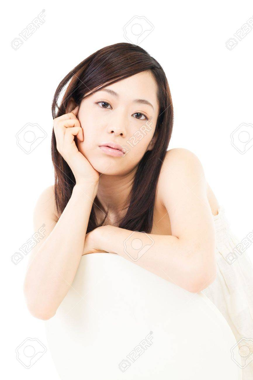 Beautiful young woman relaxing on white background Stock Photo - 15222061