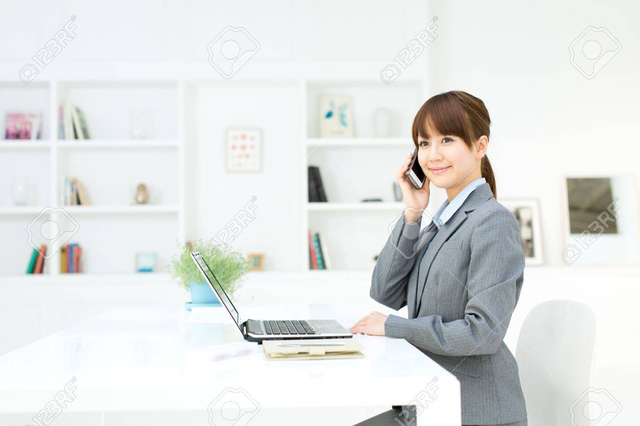 Beautiful young businesswoman working in office Stock Photo - 17273188