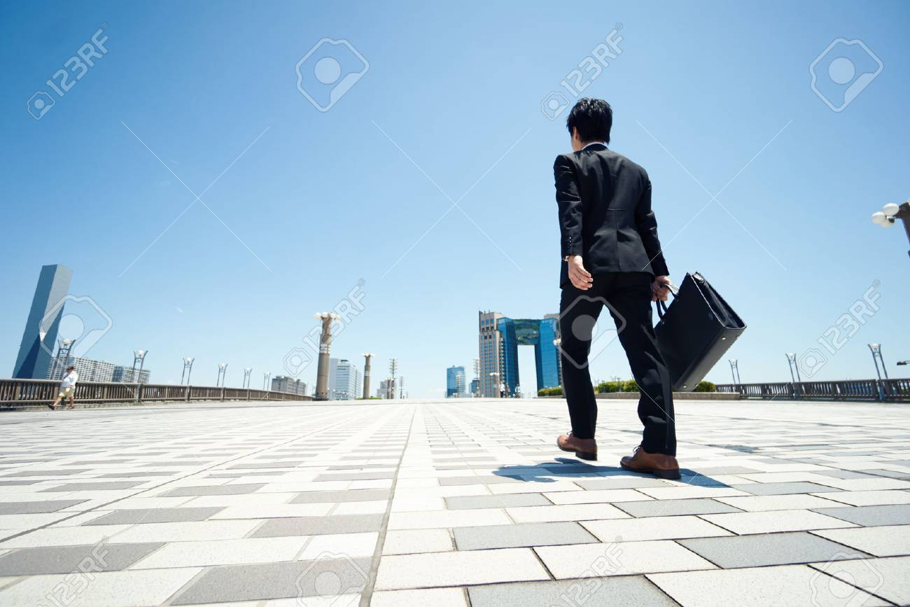 business man walking on the road - 60125030