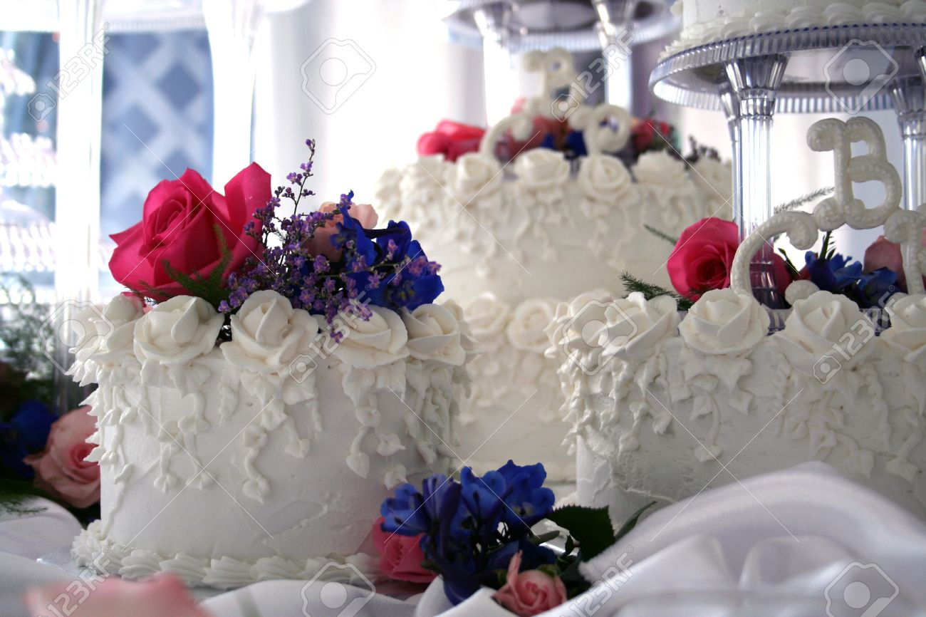 White wedding cake with colorful pink blue flowers stock photo stock photo white wedding cake with colorful pink blue flowers izmirmasajfo Images