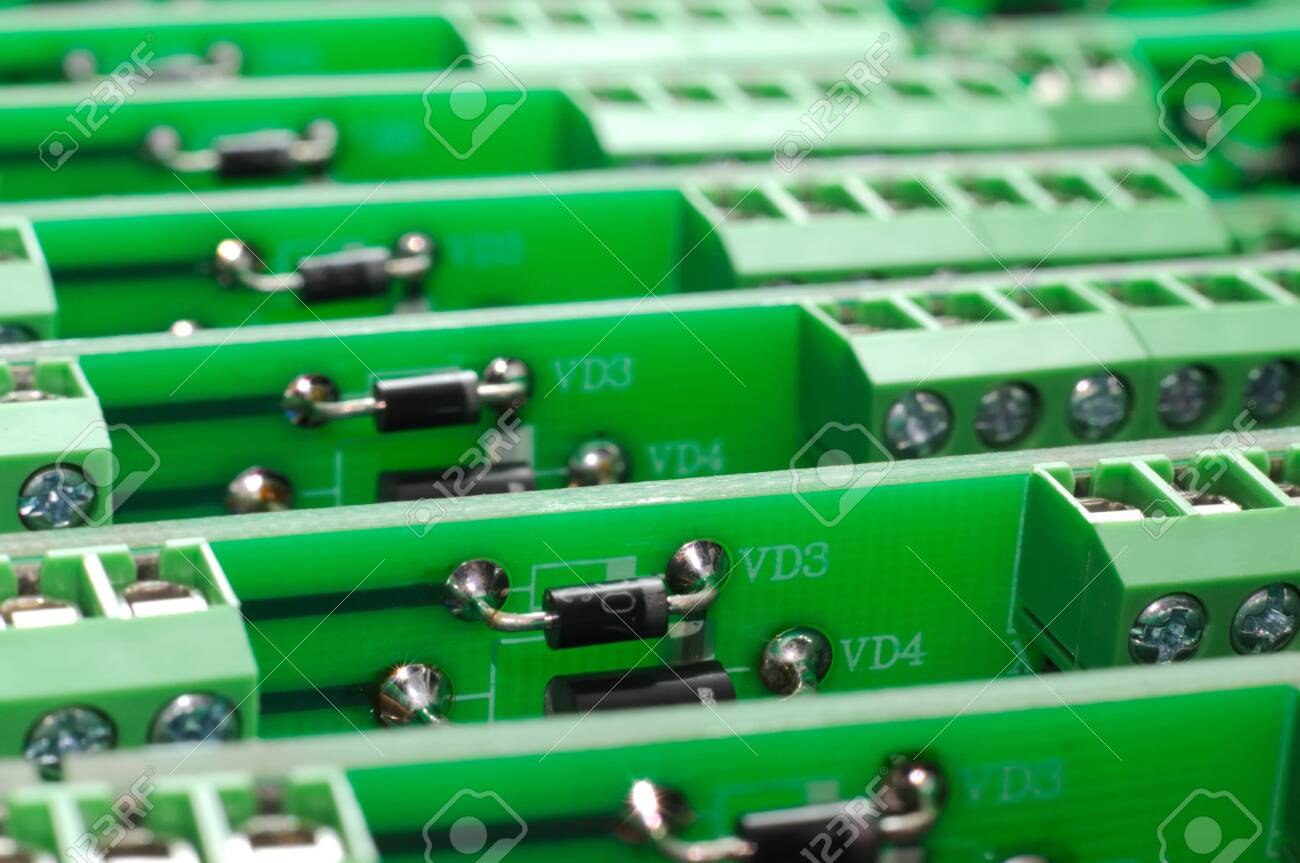 A large number of green boards with electronic components. Complex electronic equipment concept in a factory - 133942421