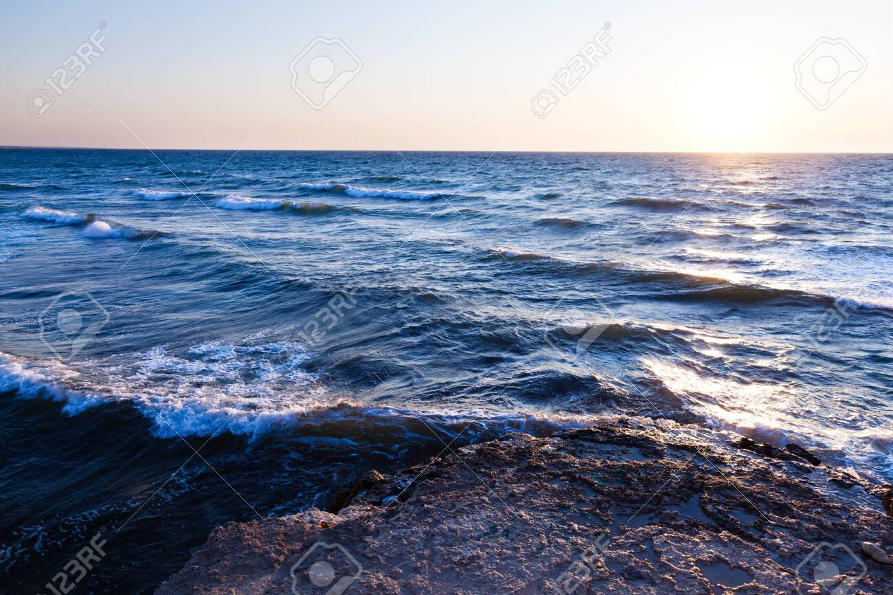 Beautiful Blue Sunset And Water Stones Over Black Sea Rocky Coastline Stock Photo Picture And Royalty Free Image Image 138599518