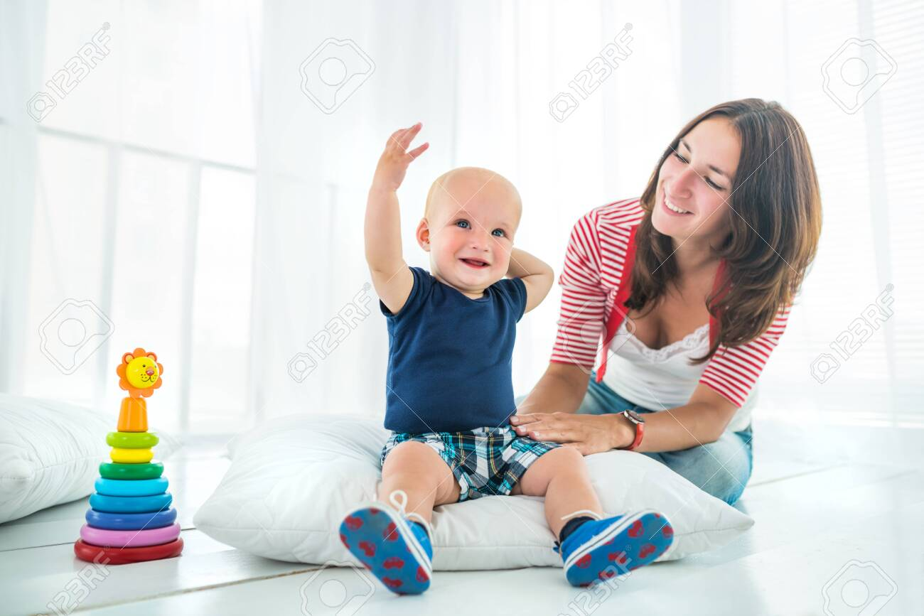 Charming cute cheerful boy with a happy caring mom - 139225148