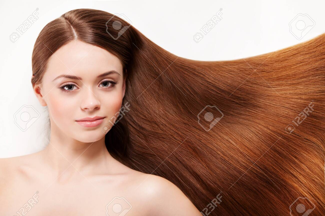 Beautiful woman with her long brown hair - 139823517