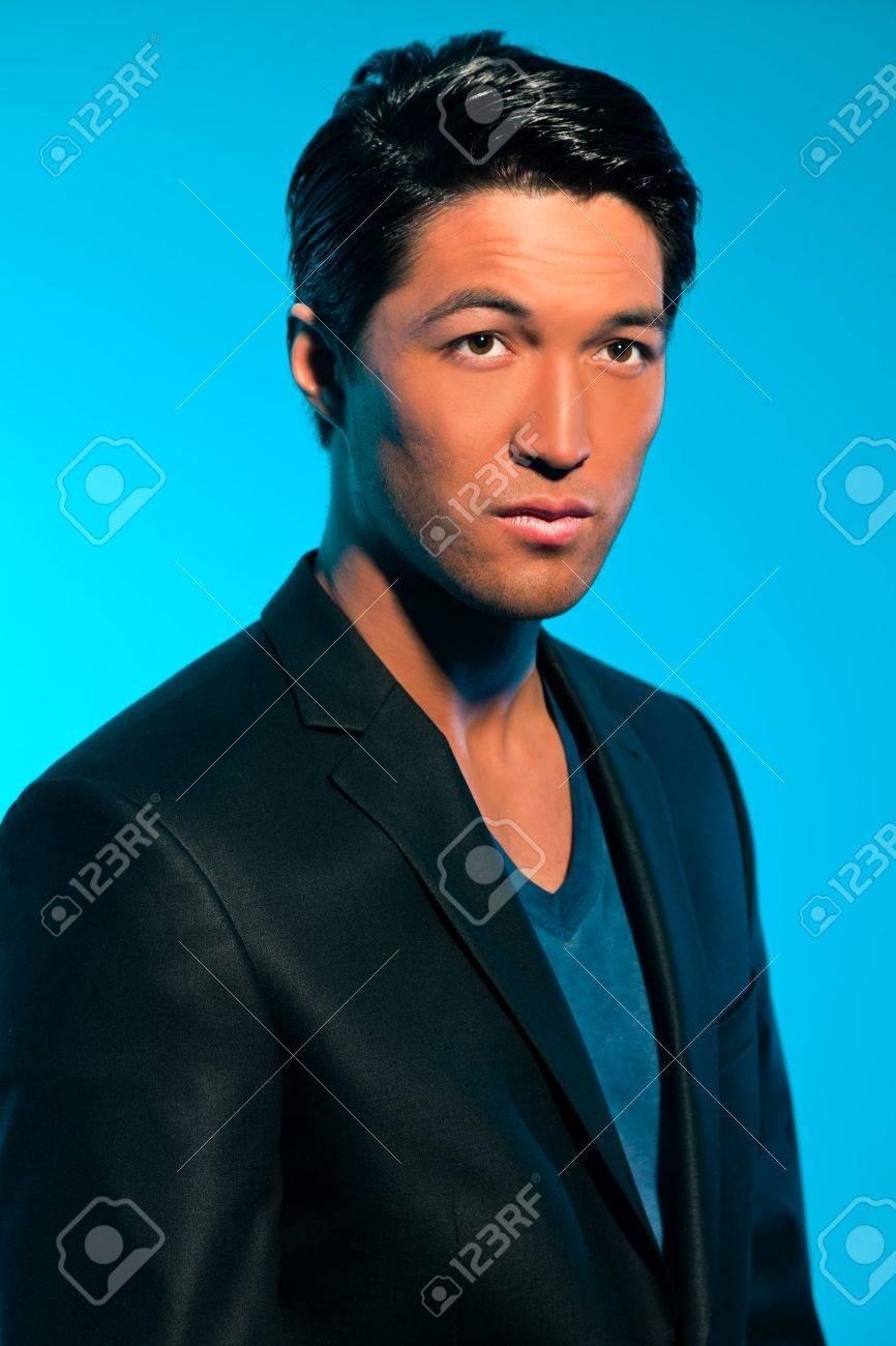 Handsome asian man in suit. Summer fashion. Studio shot. Stock Photo - 17802730
