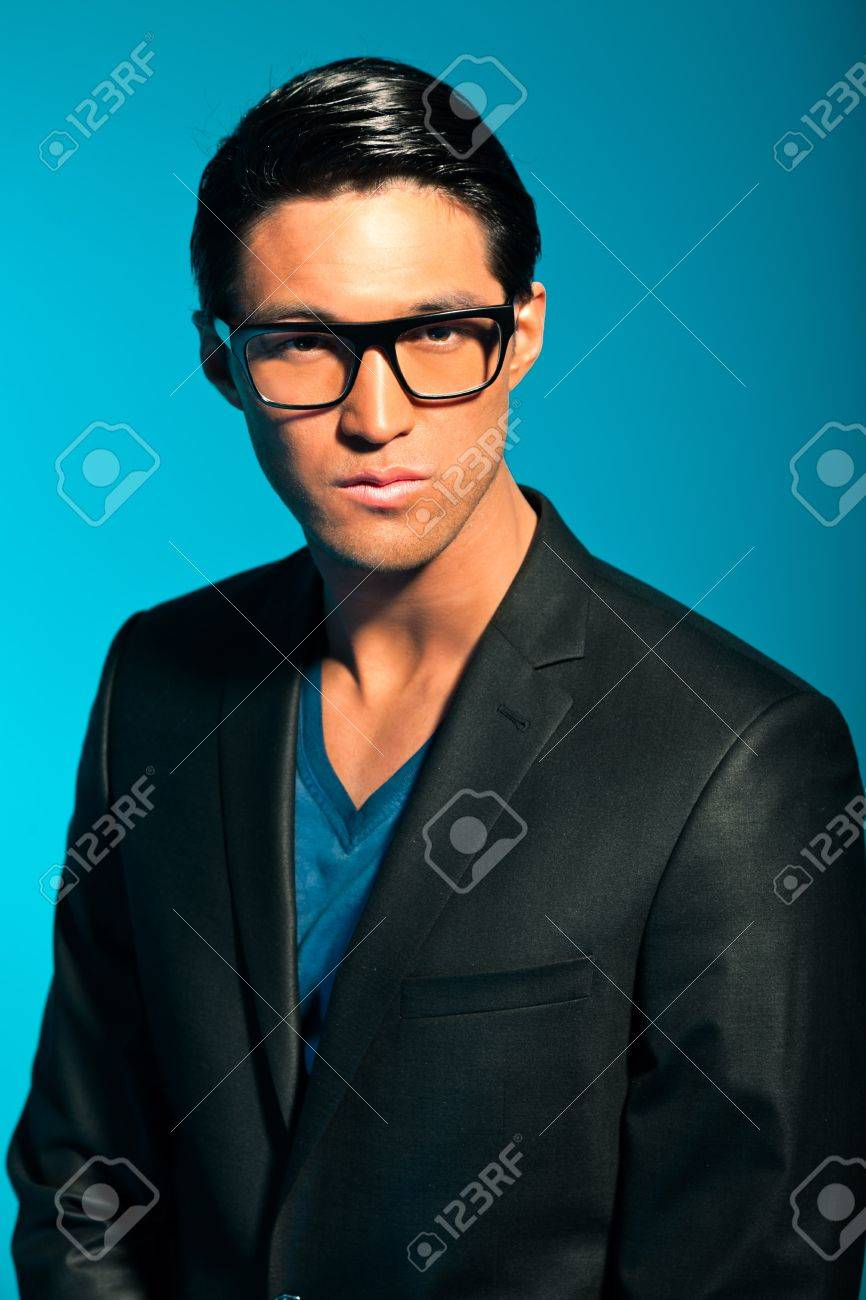 Asian man wearing suit and glasses. Summer fashion. Studio. Stock Photo - 17802780