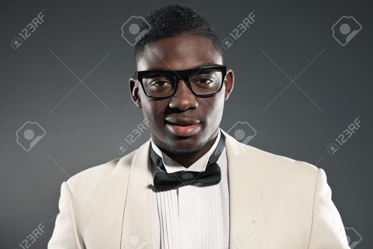 Stylish black american man in suit with glasses. Fashion studio shot. Stock Photo - 18183382