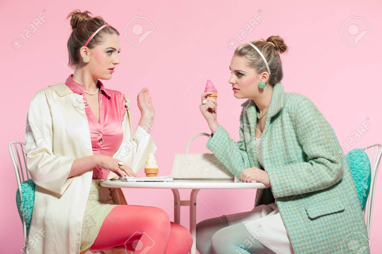 Two Girls Blonde Hair Fifties Fashion Style Eating Ice Cream Stock