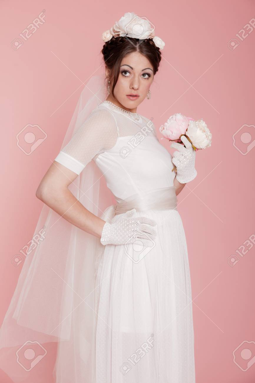 Retro Romantic Bride In White Wedding Dress Decorated With Flowers
