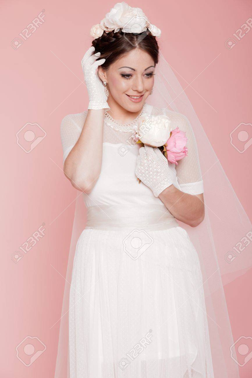 Retro Romantic Bride In White Wedding Dress. Decorated With Flowers ...