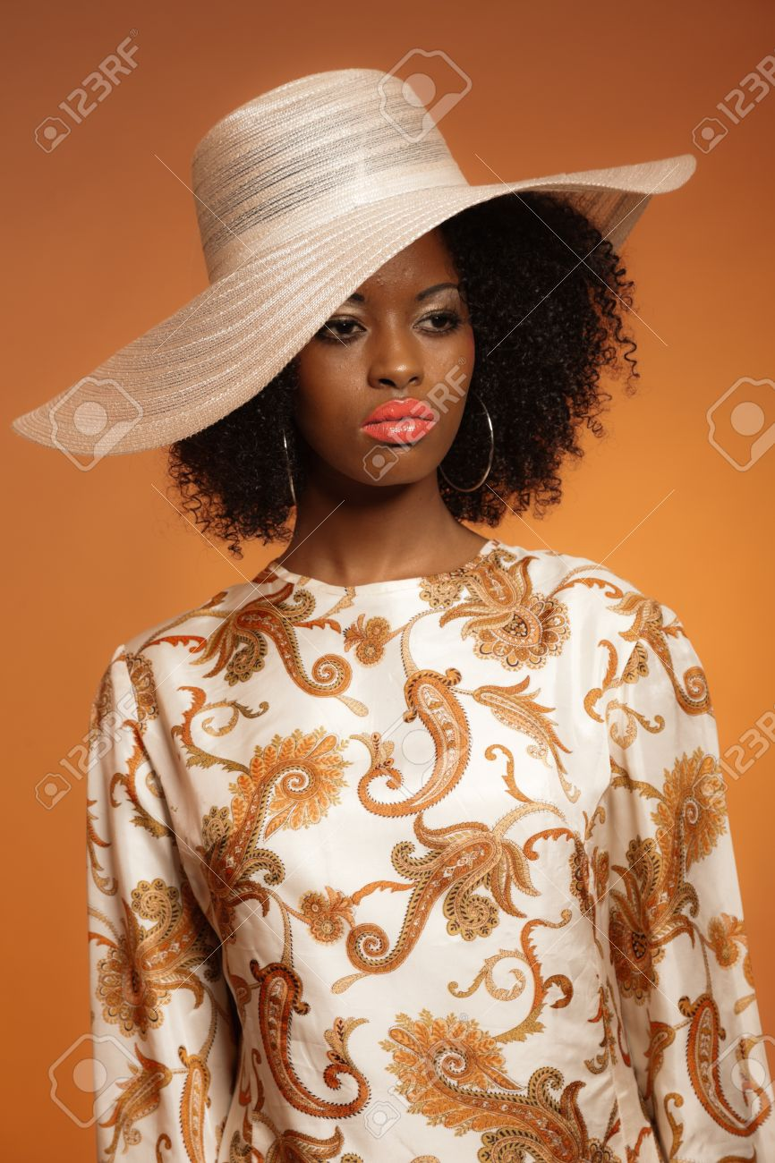 Retro 70s Fashion Afro Woman With Paisley Dress And White Hat