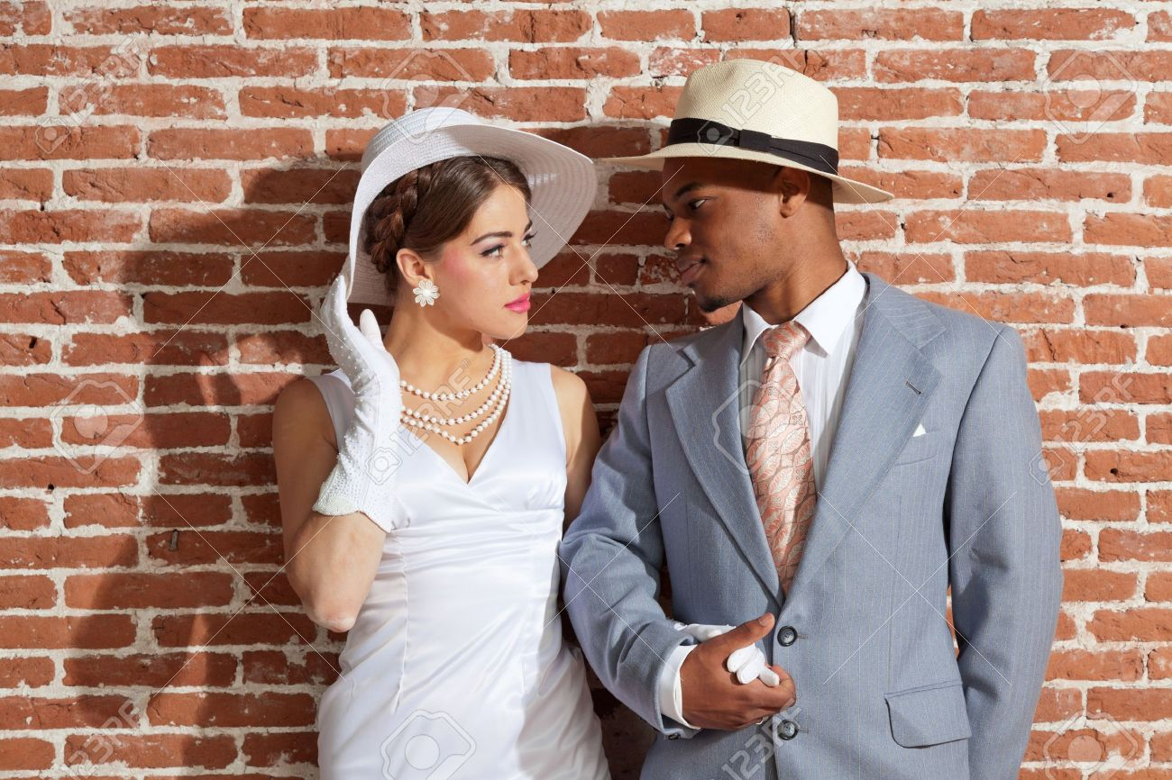 Stock Photo - Vintage jazz fashion sexy wedding couple in old urban  building. Mixed race. Wearing a hat. dff33b4d941