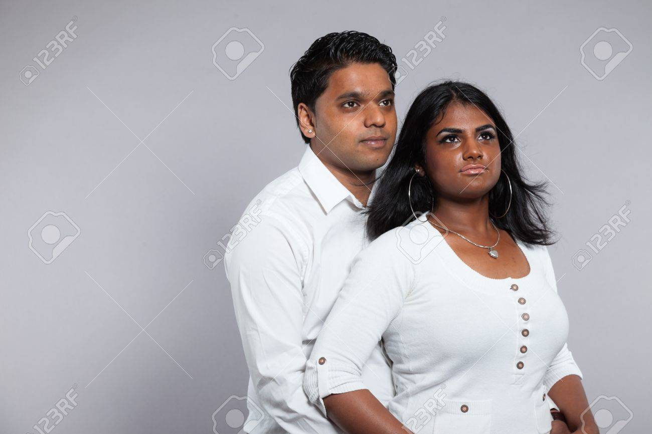 Young Romantic Indian Couple. Wearing White Shirt And Jeans ...