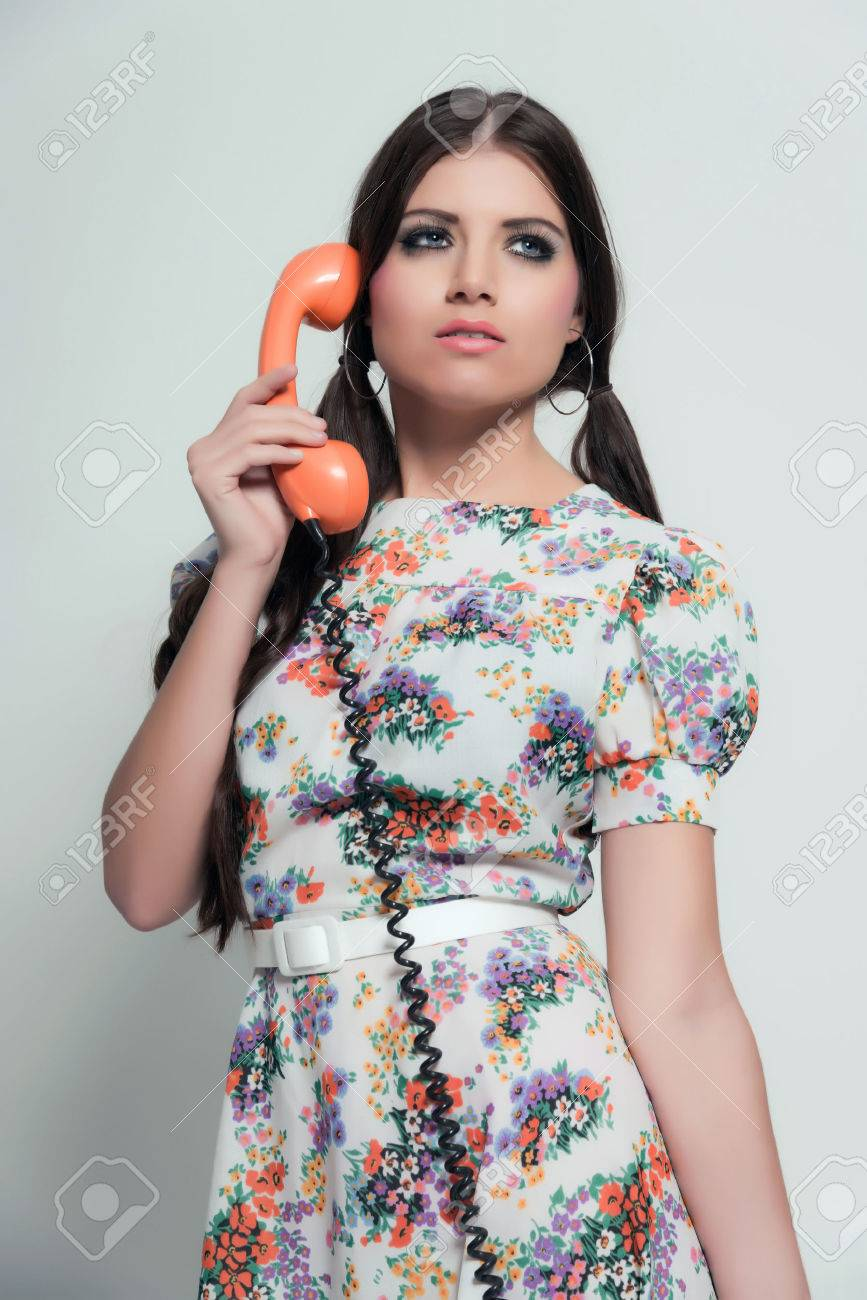 Retro 70s Fashion Pretty Brunette Girl With Long Hair Calling