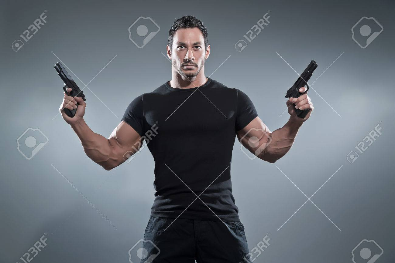 Black t shirt grey pants - Action Hero Muscled Man Holding Two Guns Wearing Black T Shirt And Pants