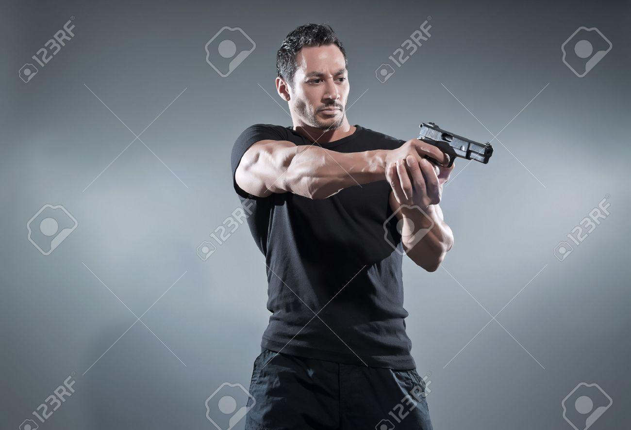 Black t shirt grey pants - Action Hero Muscled Man Shooting With Gun Wearing Black T Shirt And Pants
