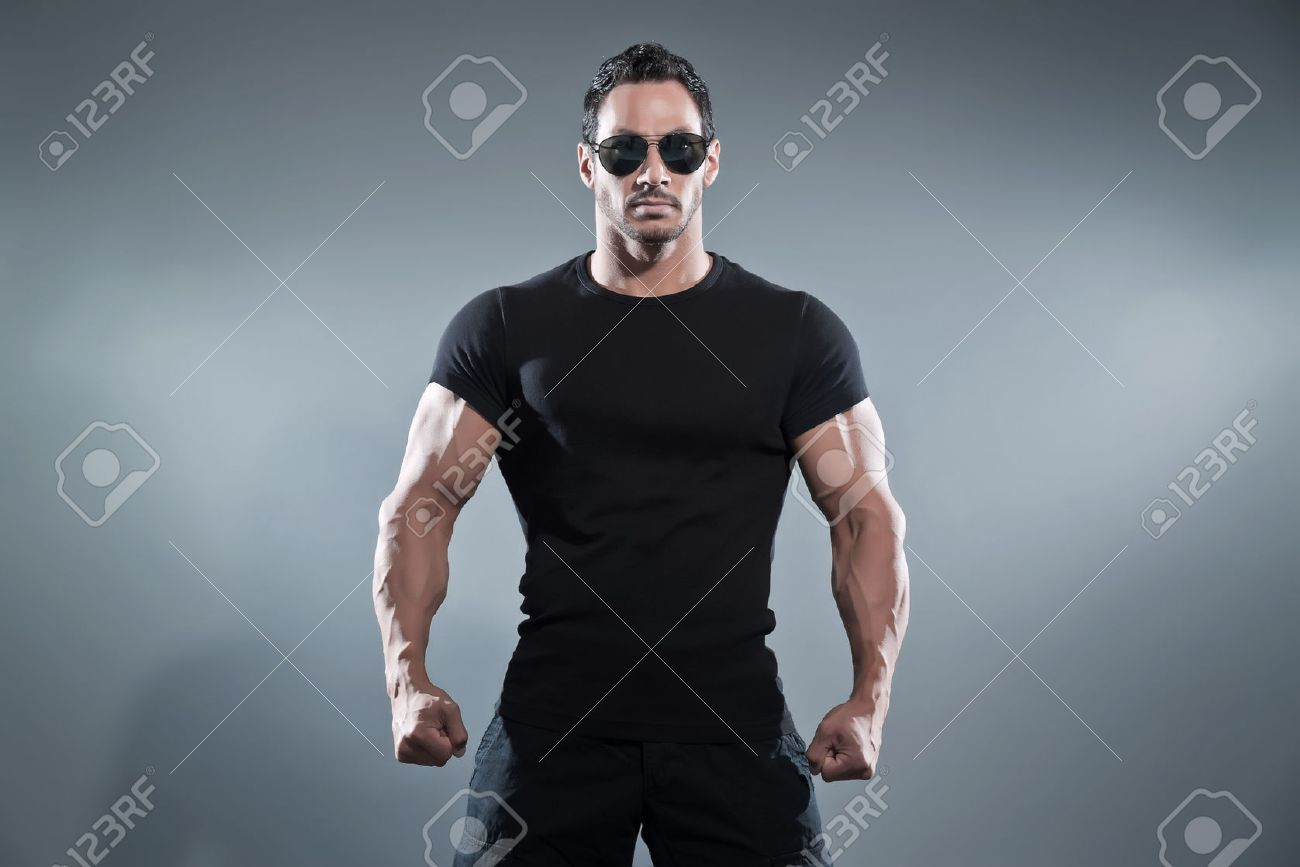 Black t shirt grey pants - Combat Muscled Action Hero Man Wearing Black T Shirt With Pants And Sunglasses Studio