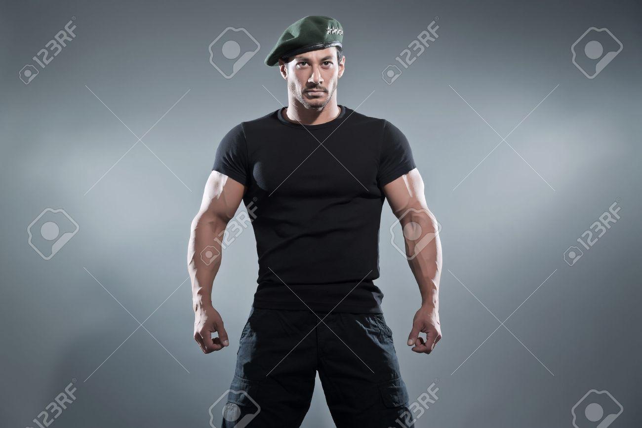 Black t shirt grey pants - Commander Muscled Action Hero Man Wearing Black T Shirt And Pants Studio Shot Against
